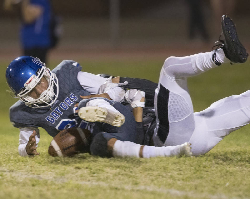 Green Valley freshman quarterback Anton Mazzulo (26) tries to recover a fumble with a Palo Verd ...