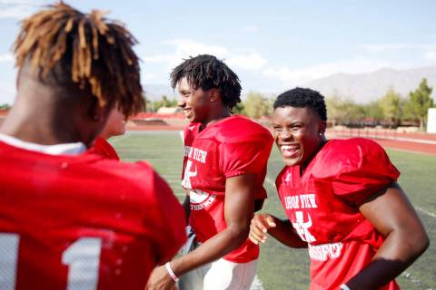 Arbor View running backs Daniel Mitchell (24), center, and Darius Williams (30), during practi ...