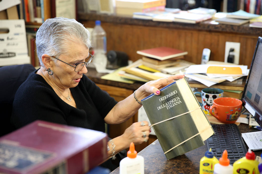 Myrna Donato, owner of Amber Unicorn Books at 2101 S. Decatur Blvd. in Las Vegas, repairs a boo ...