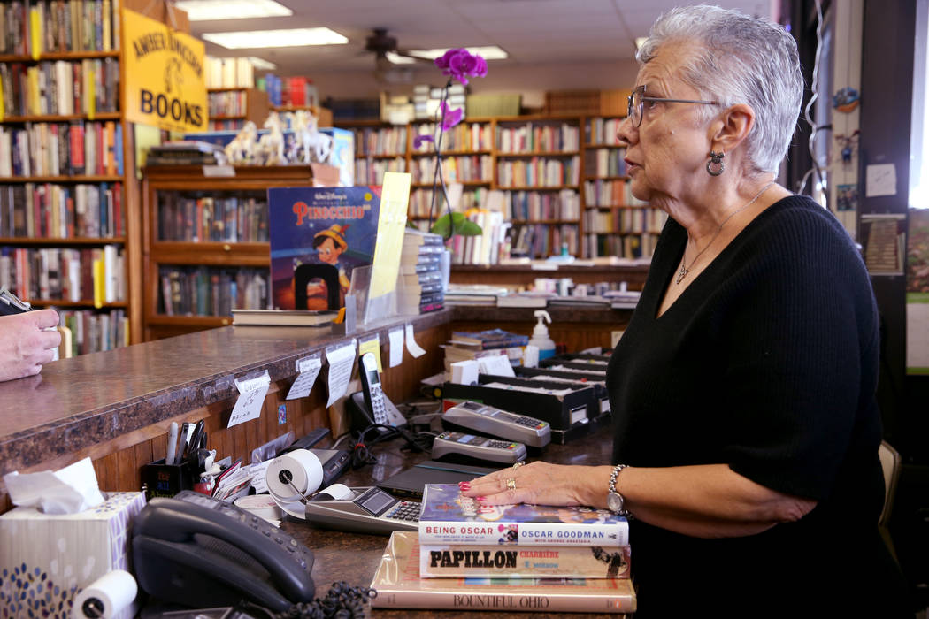 Myrna Donato, owner of Amber Unicorn Books at 2101 S. Decatur Blvd. in Las Vegas, talks to a re ...