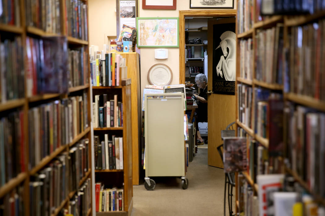 Myrna Donato, owner of Amber Unicorn Books at 2101 S. Decatur Blvd. in Las Vegas, works in her ...