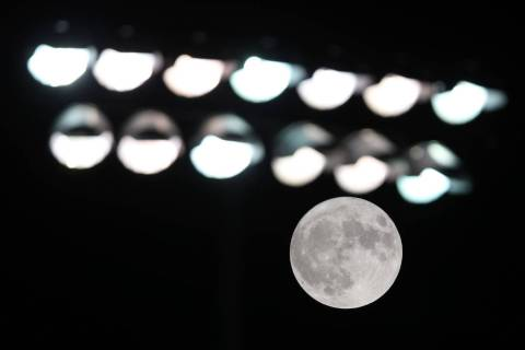 The Harvest Moon rises behind the field light during a game between Clark and Chaparral at Chap ...