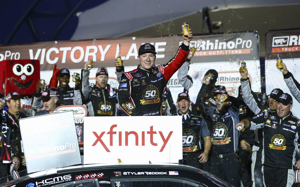 Tyler Reddick, center, celebrates after winning a NASCAR Xfinity Series auto race at Las Vegas ...