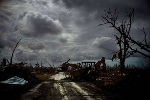 Mos Antenor, 42, drives a bulldozer while clearing the road after Hurricane Dorian Mclean's Tow ...