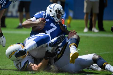 Indianapolis Colts quarterback Jacoby Brissett is sacked by Los Angeles Chargers defensive end ...