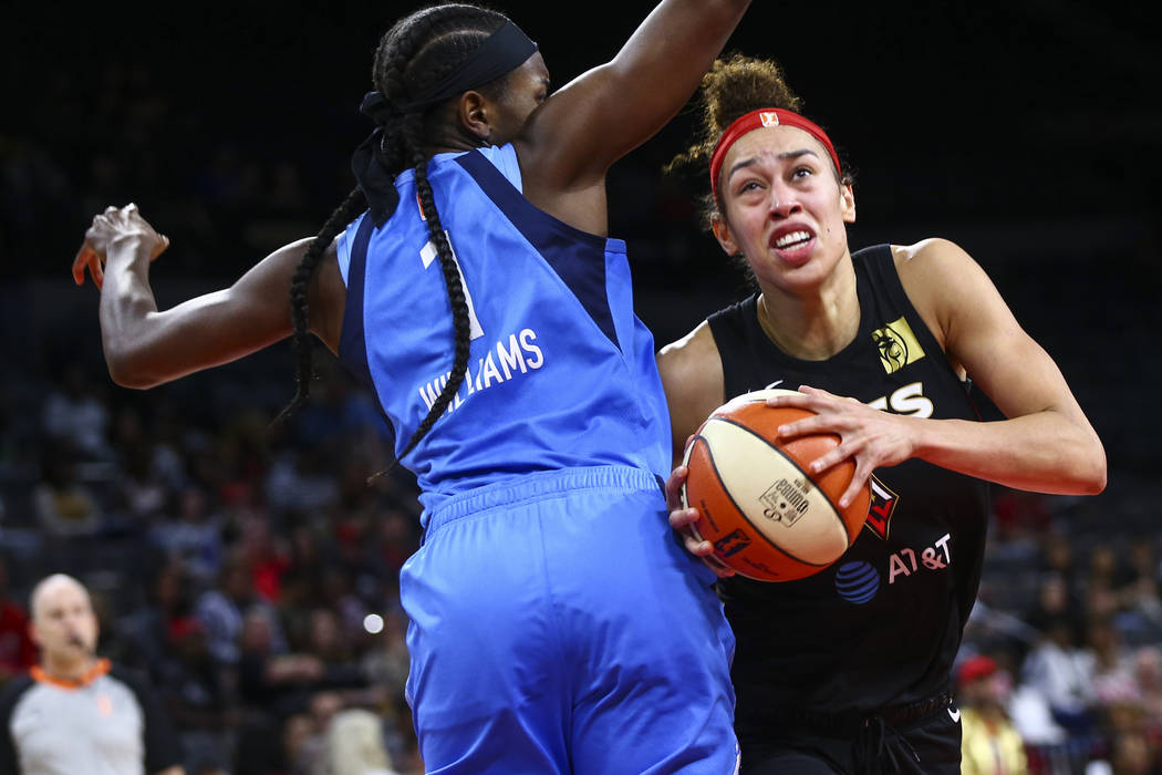 Las Vegas Aces' Dearica Hamby moves the ball around Atlanta Dream's Elizabeth Williams (1) duri ...