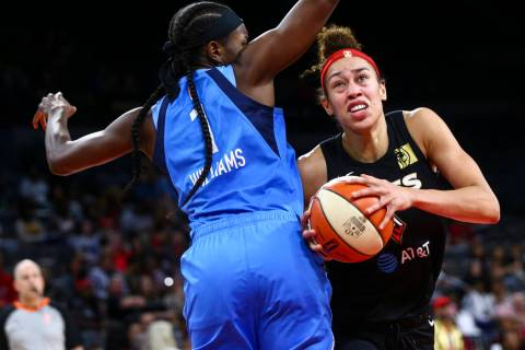 Las Vegas Aces' Dearica Hamby moves the ball around Atlanta Dream's Elizabeth Williams (1) duri ...