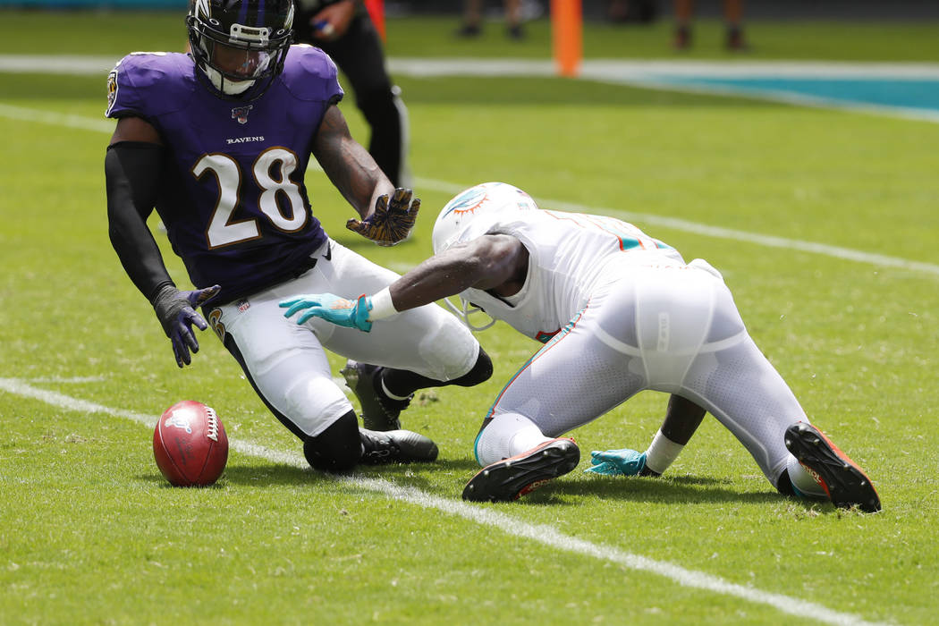 Miami Dolphins wide receiver Jakeem Grant (19) drops a punt return as Baltimore Ravens defensiv ...