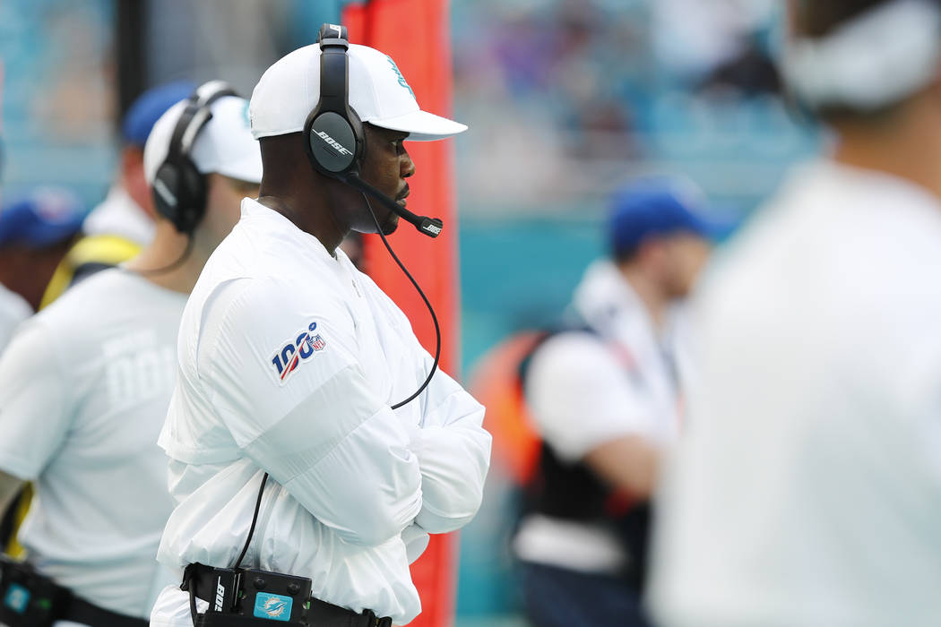 Miami Dolphins head coach Brian Flores looks from the sidelines, during the second half at an N ...