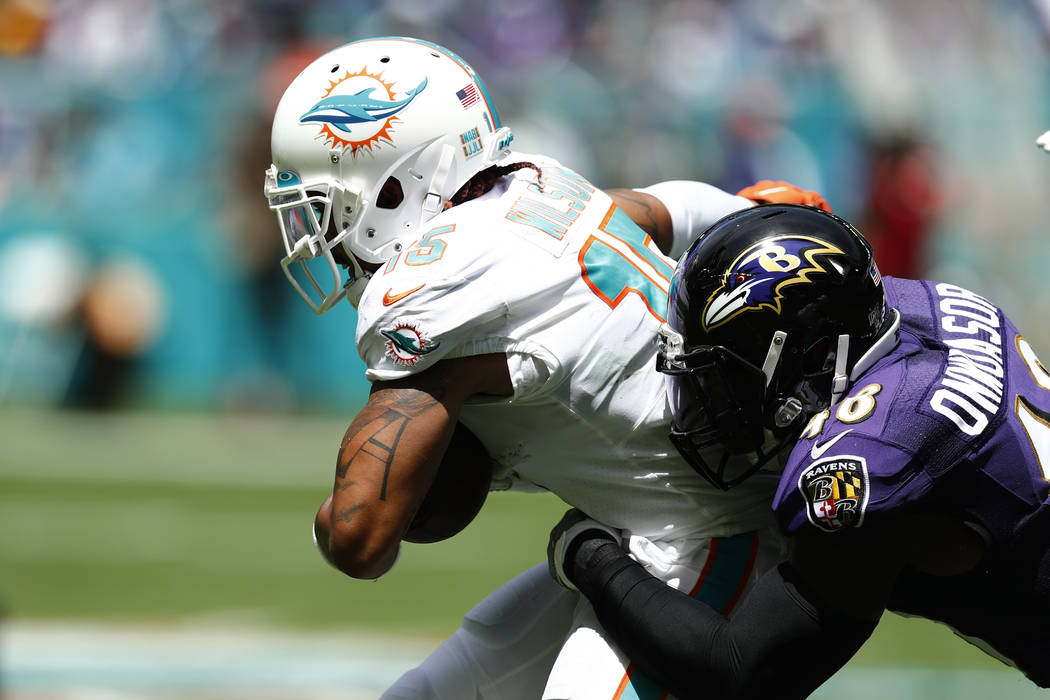 FILE - In this Sept. 8, 2019, file photo, Miami Dolphins wide receiver Albert Wilson (15) is ta ...