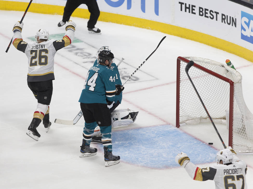 Golden Knights center Paul Stastny (26) celebrates with teammate Max Pacioretty (67) after a th ...