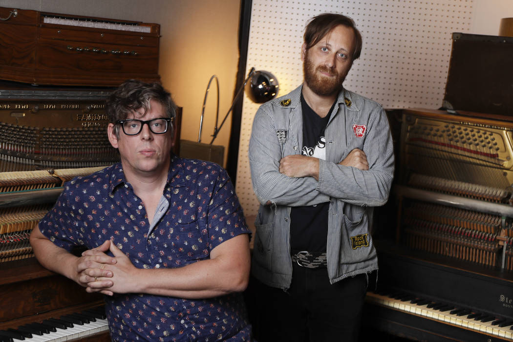 In this Aug. 19, 2019, photo, Patrick Carney, left, and Dan Auerbach of The Black Keys pose for ...