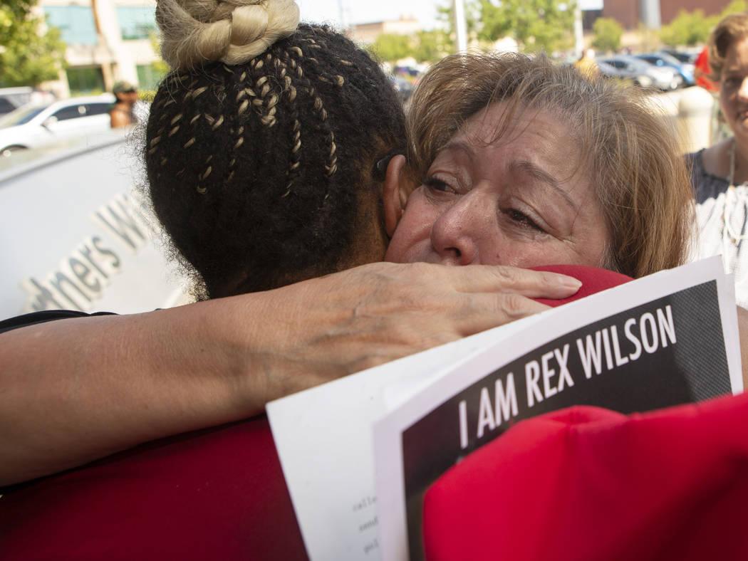 Alma Chavez, left, whose son, Rafael Olivas, was shot by Las Vegas police officers in 2011, hug ...