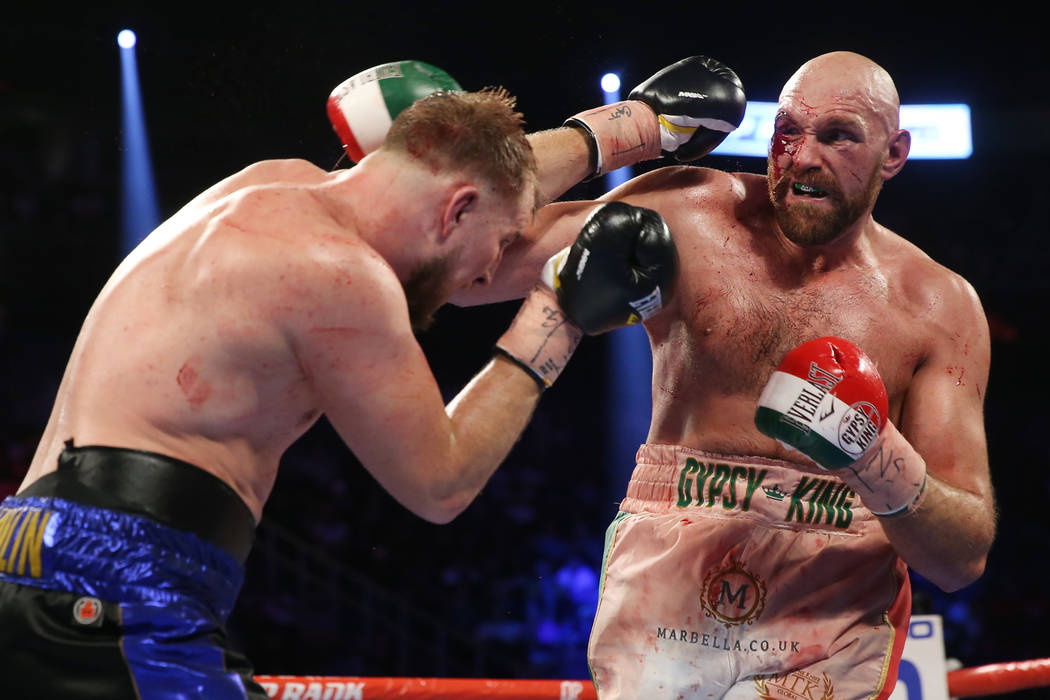 Otto Wallin, left, battles Tyson Fury in the 12th round of the heavyweight bout at T-Mobile Are ...