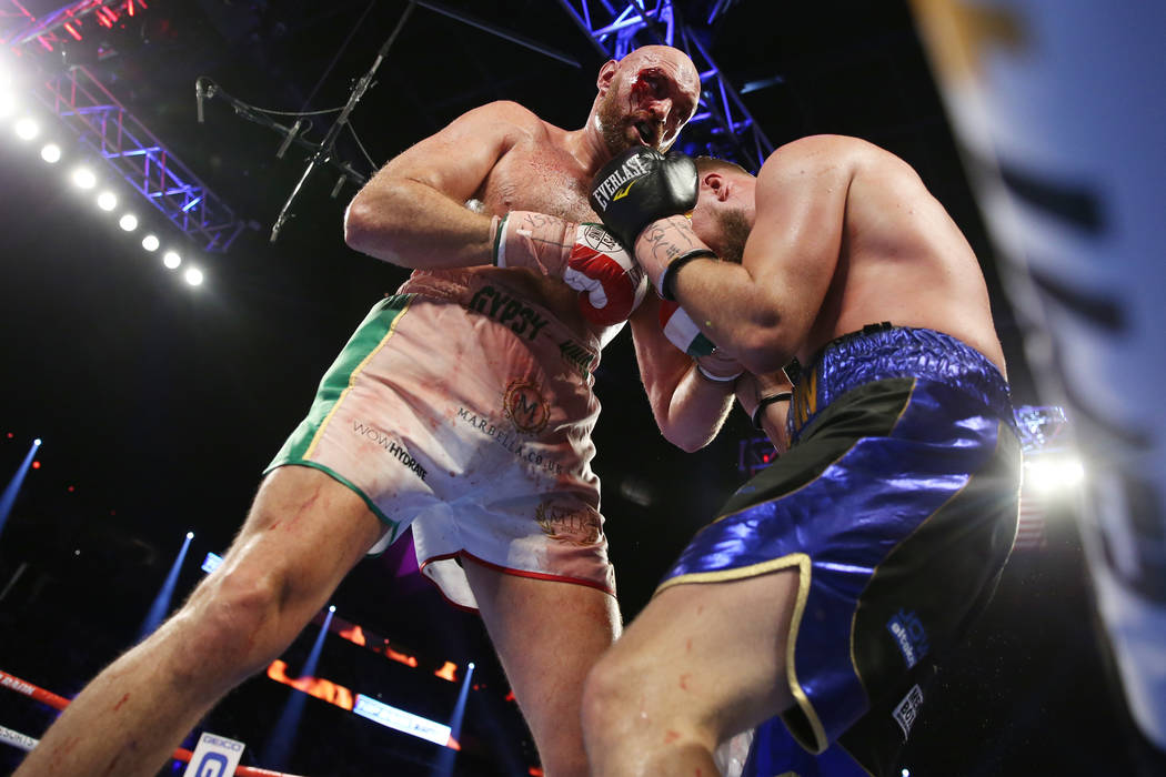 Tyson Fury, left, battles Otto Wallin in the 11th round of the heavyweight bout at T-Mobile Are ...