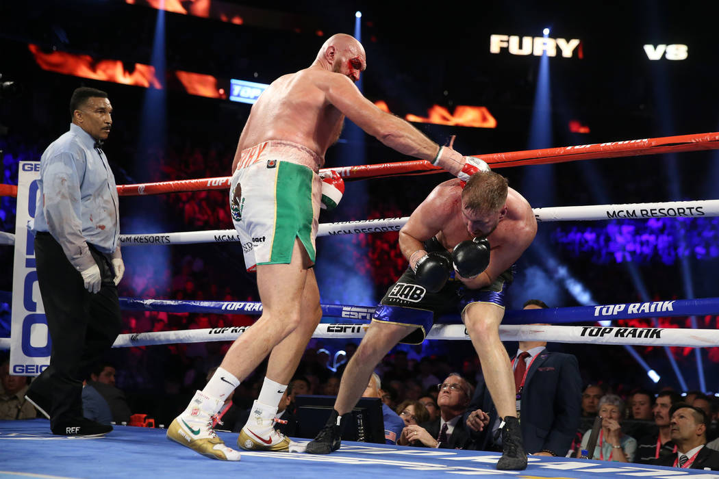 Tyson Fury, left, battles Otto Wallin in the heavyweight bout at T-Mobile Arena in Las Vegas, S ...