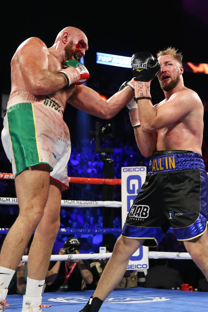 Tyson Fury, left, connects a punch against Otto Wallin in the ninth round of the heavyweight bo ...