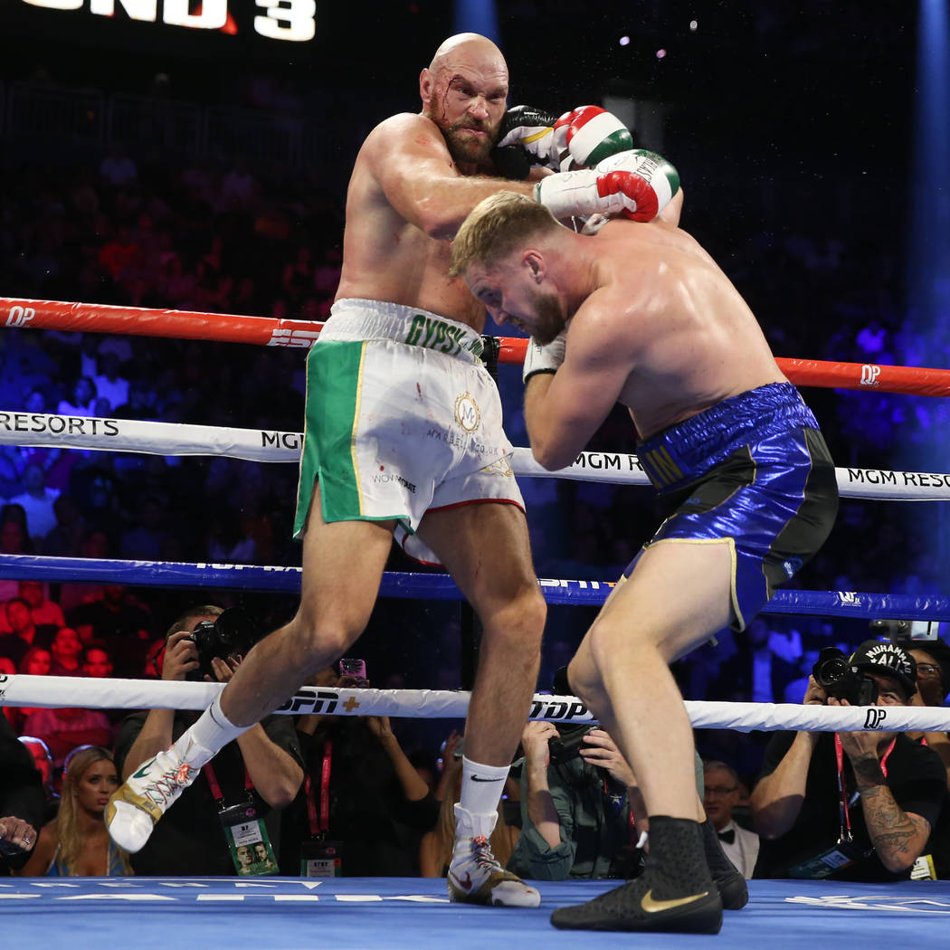 Tyson Fury, left, battles Otto Wallin in the third round of the heavyweight bout at T-Mobile Ar ...