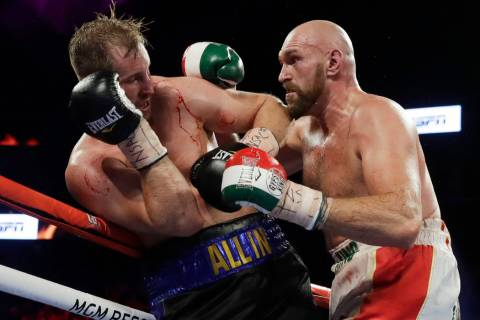 Tyson Fury, right, of England, punches Otto Wallin, of Sweden, during their heavyweight boxing ...