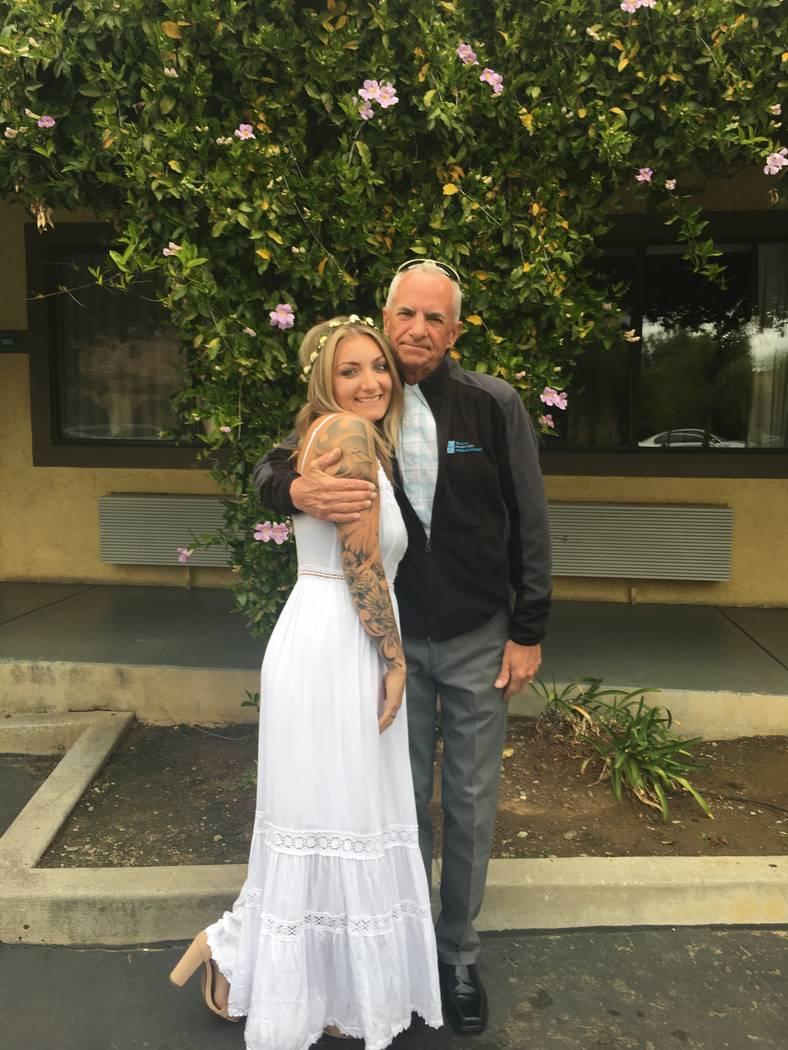 John McCarthy and his step-daughter, Katie Seelie, during Seelie's wedding in February 2019. Se ...