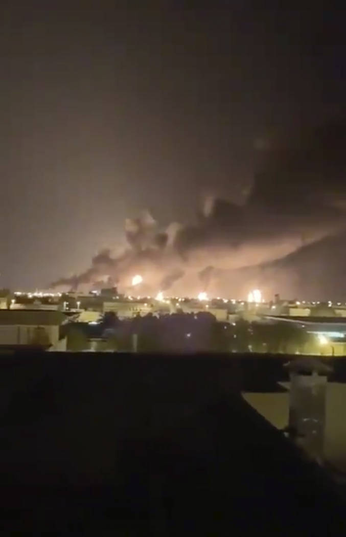 Smoke fills the sky at the Abqaiq oil processing facility on Saturday, Sept. 14, 2019 in Saudi ...
