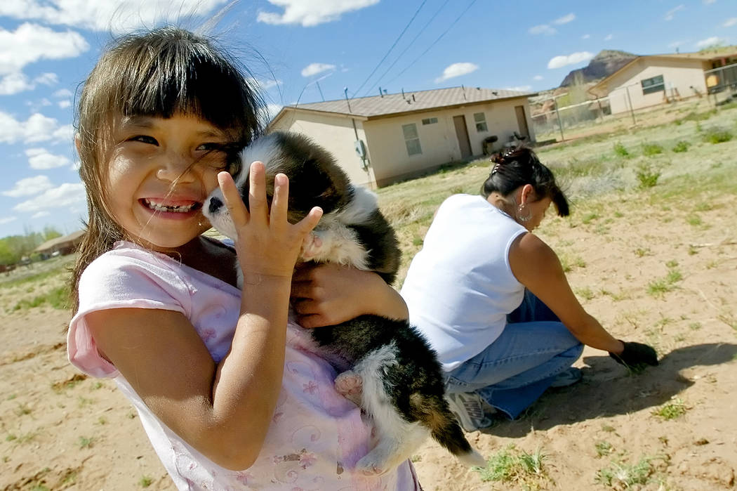 In this Tuesday, April 17, 2007 file photo, Cheyenne Yazzi hugs her puppy while her mother, Sel ...