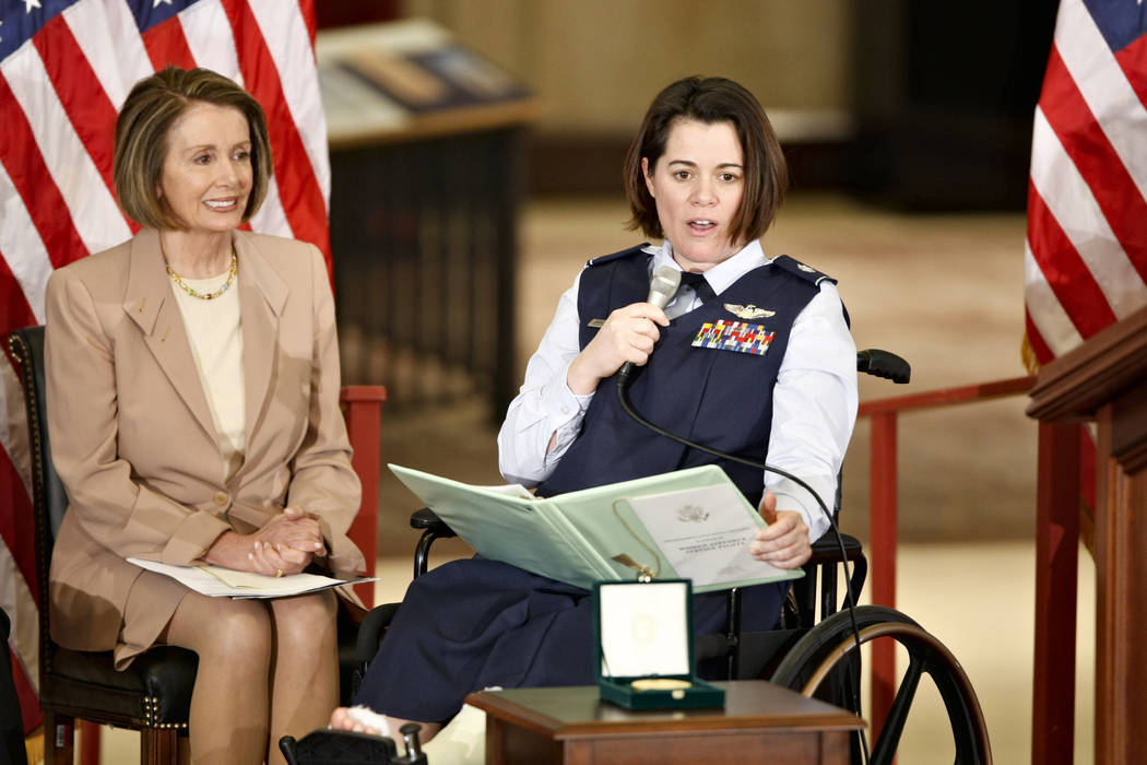 In this March 10, 2010 file photo, Air Force Lt. Col. Nicole Malachowski, right, is joined by H ...