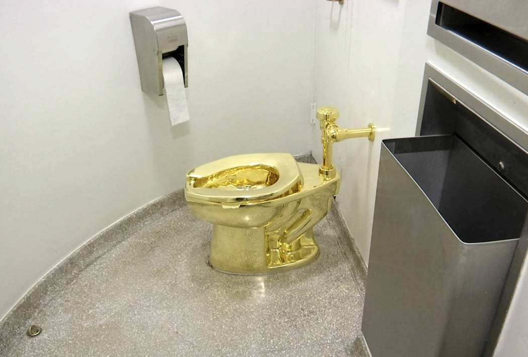 """This Sept. 16, 2016 file image made from a video shows the 18-karat toilet, titled """"America,"""" b ..."""