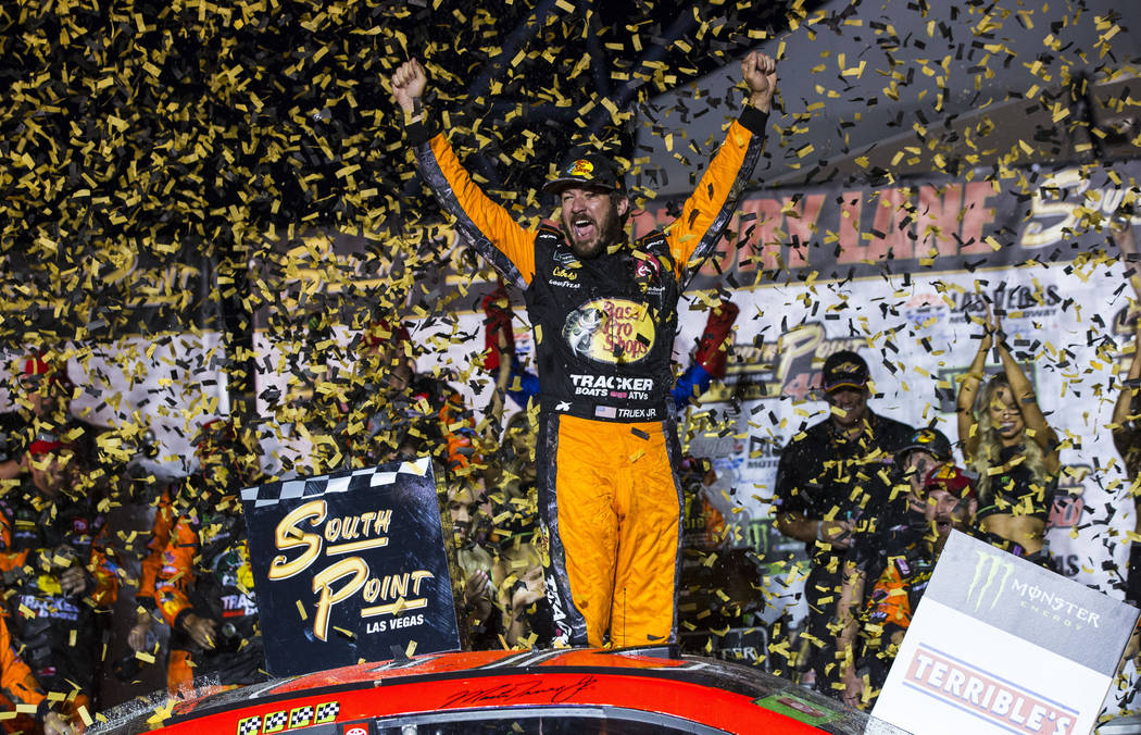 Martin Truex Jr. celebrates after winning a NASCAR Cup Series auto race at the Las Vegas Motor ...