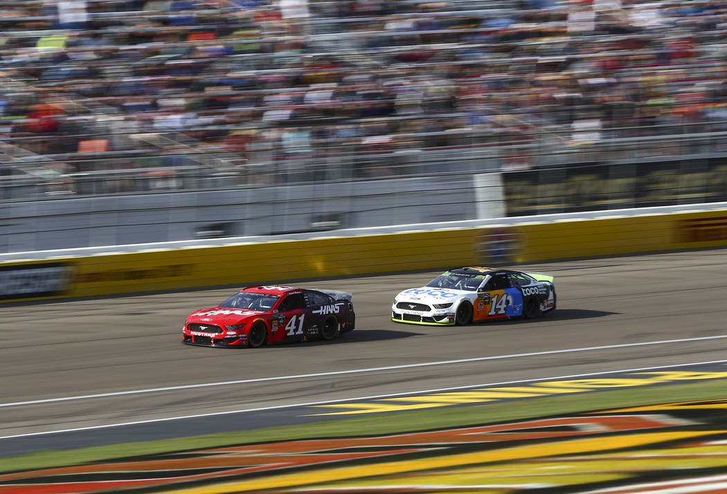 Daniel Suarez (41) and Clint Bowyer (14) drive during a NASCAR Cup Series auto race at Las Vega ...