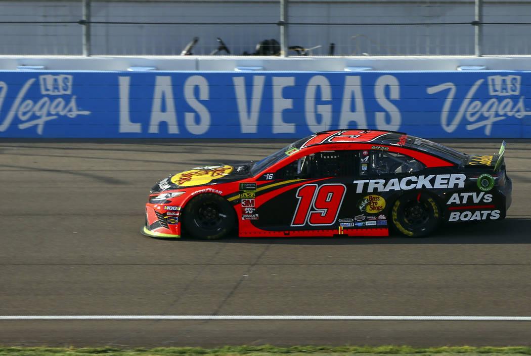 Martin Truex Jr. (19) drives during a NASCAR Cup Series auto race at Las Vegas Motor Speedway, ...