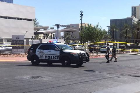 Las Vegas police are investigating reports of a suspicious package Sunday morning near downtown ...