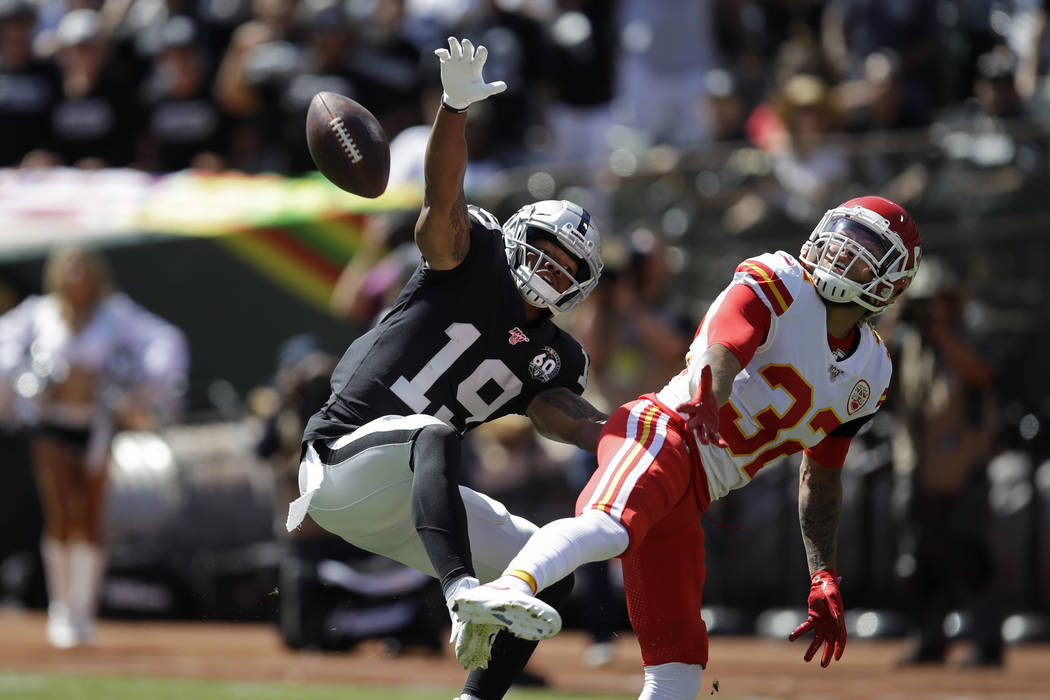 Oakland Raiders wide receiver Ryan Grant (19) goes up for a pass as Kansas City Chiefs strong s ...