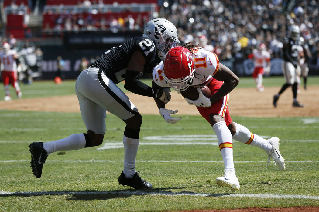 Kansas City Chiefs wide receiver Demarcus Robinson (11) scores a touchdown as Oakland Raiders c ...