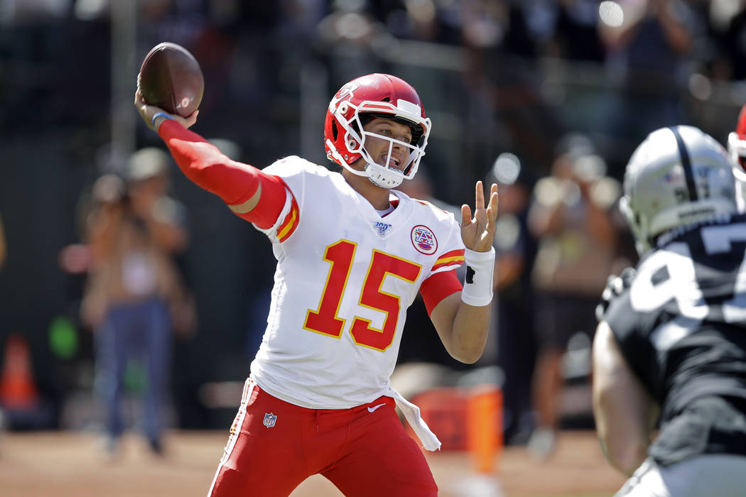 Kansas City Chiefs quarterback Patrick Mahomes during the first half of an NFL football game ag ...