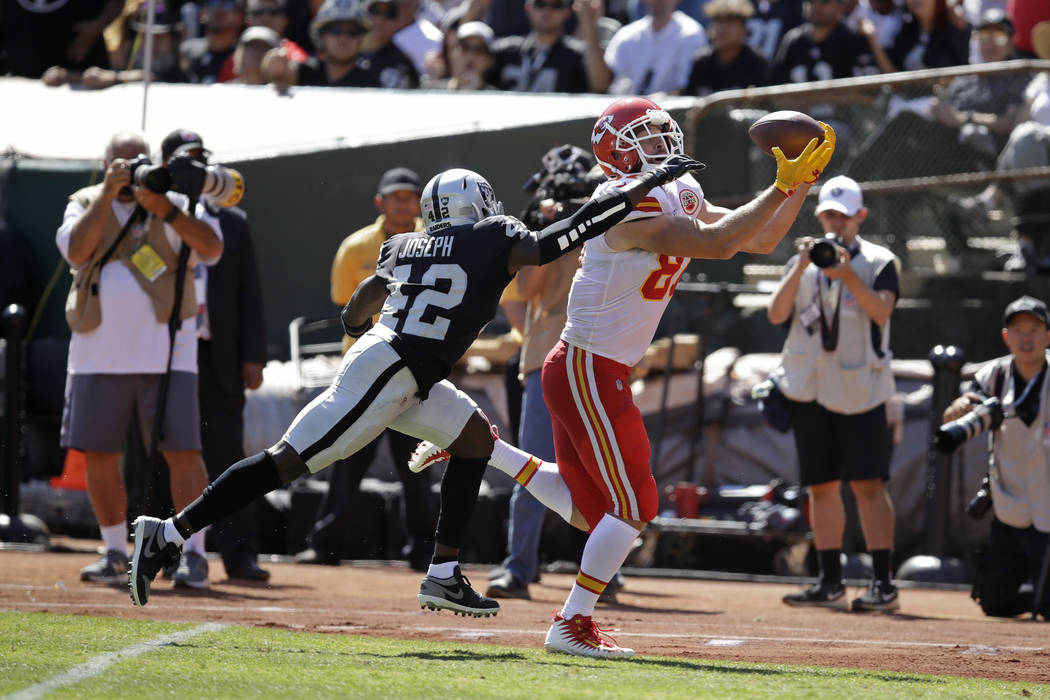 Kansas City Chiefs tight end Travis Kelce scores a touchdown as Oakland Raiders free safety Kar ...