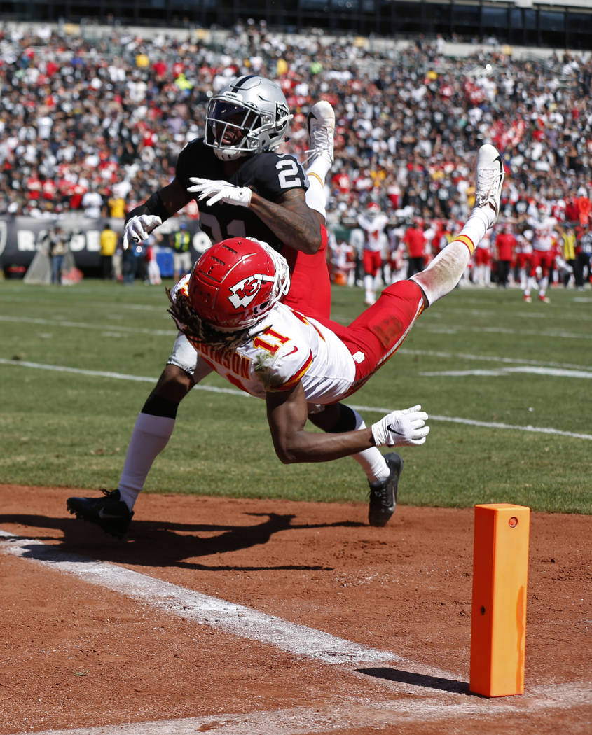 Kansas City Chiefs wide receiver Demarcus Robinson (11) scores a touchdown as Oakland Raiders c ...