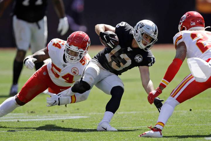 Oakland Raiders wide receiver Hunter Renfrow (13) is stopped with the ball by Kansas City Chief ...
