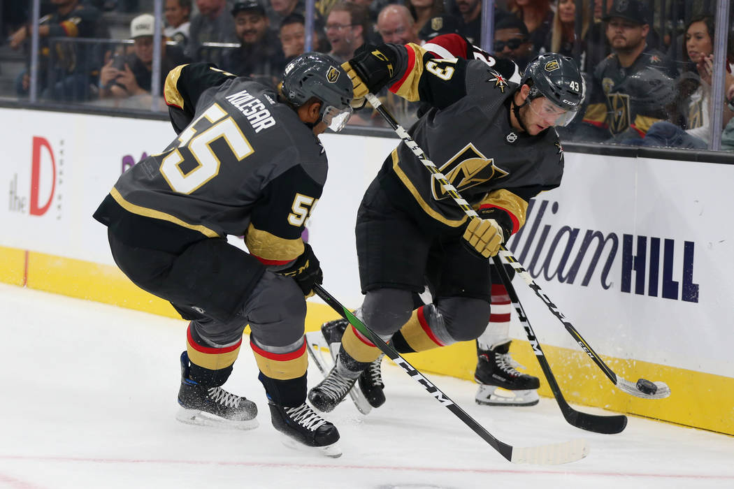 Vegas Golden Knights center Paul Cotter (43) and right wing Keegan Kolesar (55) fight for the p ...