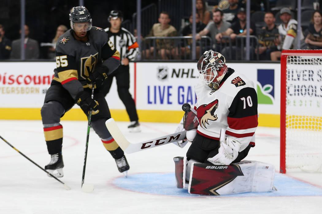 Arizona Coyotes goaltender Erik Kallgren (70) makes a stop as Vegas Golden Knights right wing K ...