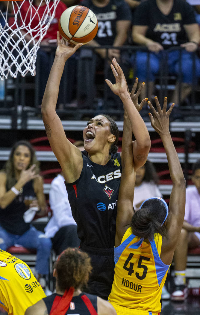Las Vegas Aces center Liz Cambage (8) shoots over Chicago Sky center Astou Ndour (45) during th ...