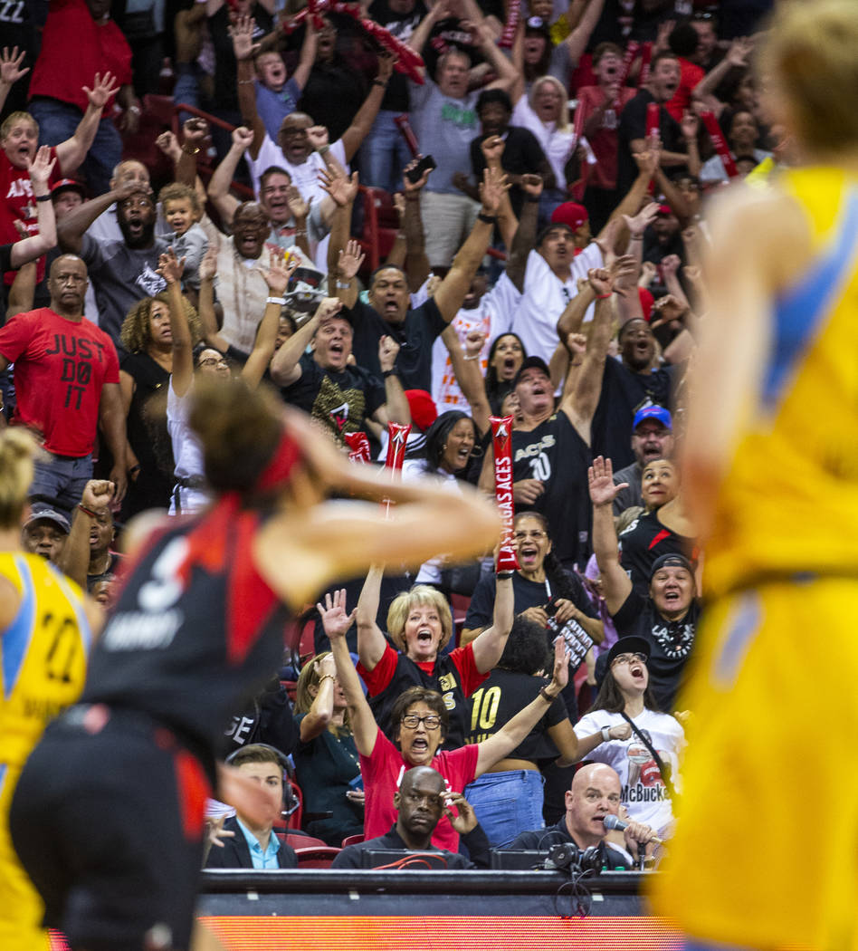 Fans go crazy after Las Vegas Aces forward Dearica Hamby (5) makes a late-game three-point-shot ...