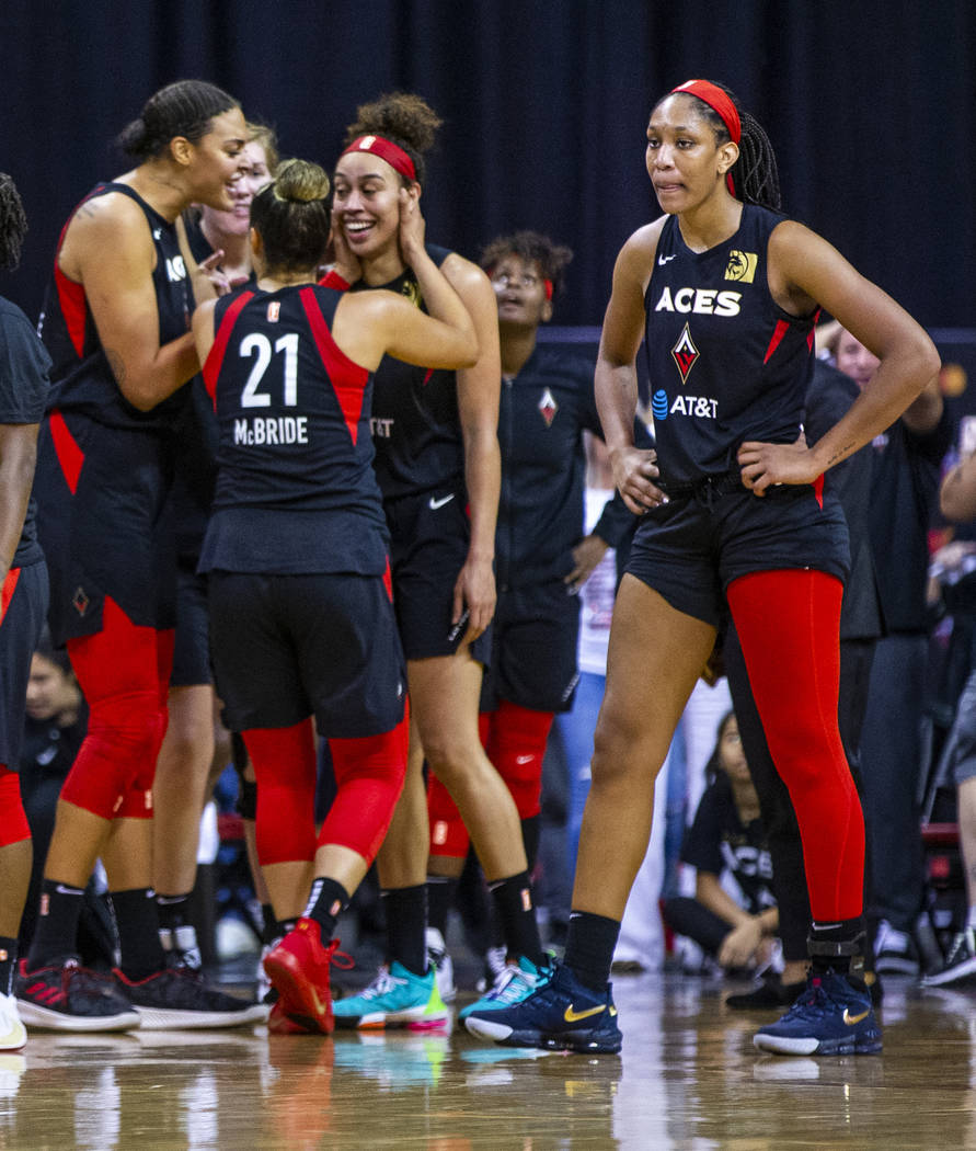 Teammates congratulate Las Vegas Aces forward Dearica Hamby (5) after making a late-game three- ...