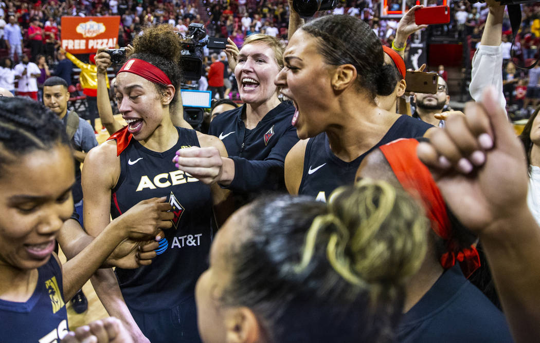 Las Vegas Aces center Liz Cambage, right, and forward Dearica Hamby, left, celebrate their 93-9 ...