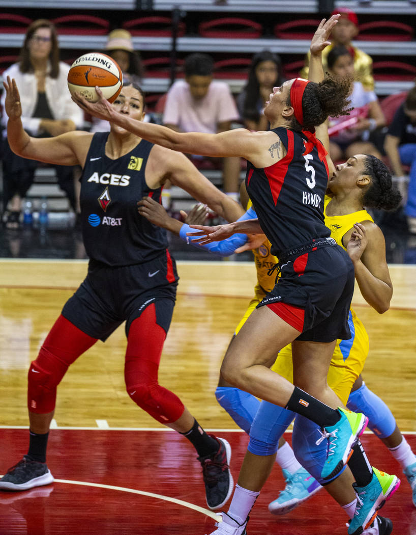 Las Vegas Aces forward Dearica Hamby (5) readies to lay the ball in over the Chicago Sky during ...