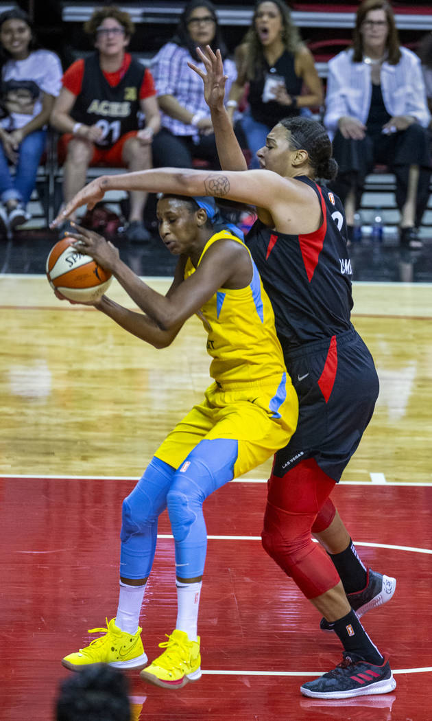 Chicago Sky center Astou Ndour (45) is defended well by Las Vegas Aces center Liz Cambage (8) d ...
