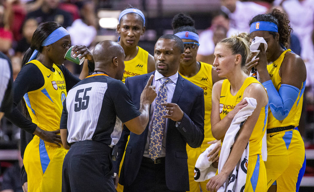 Chicago Sky head coach James Wade has a foul shot rule explained to him and his players by a re ...