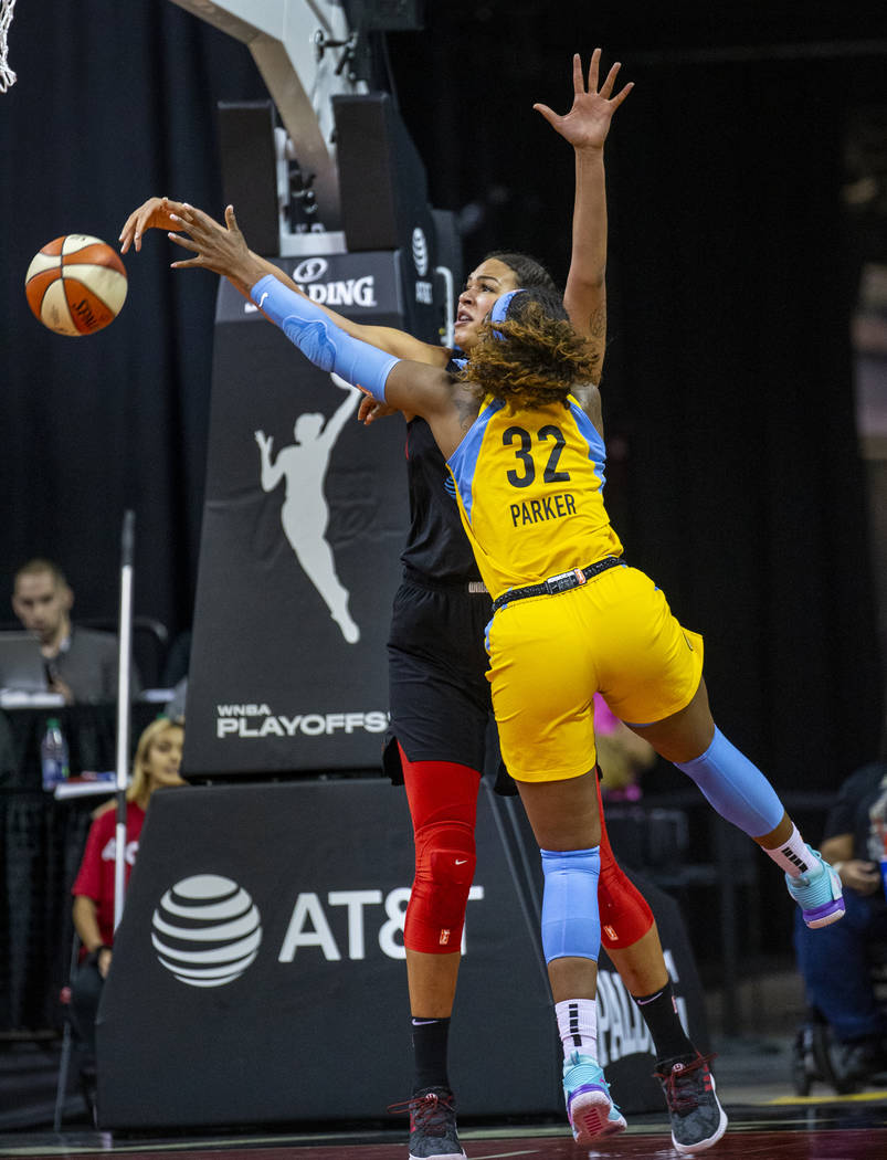 Las Vegas Aces center Liz Cambage (8) blocks a shot attempt by Chicago Sky forward Cheyenne Par ...
