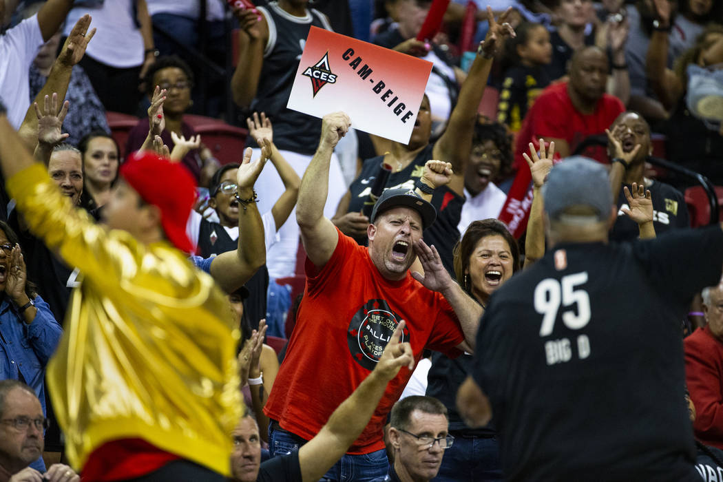 Las Vegas Aces fans cheer hard during a timeout versus the Chicago Sky in the second half of th ...