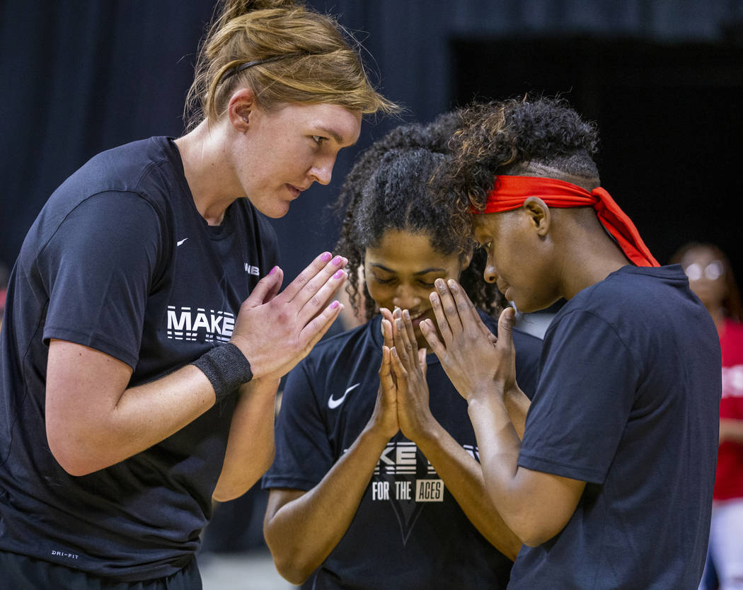 (From left) Las Vegas Aces center Carolyn Swords (4), Sydney Colson (51) and guard Sugar Rodger ...